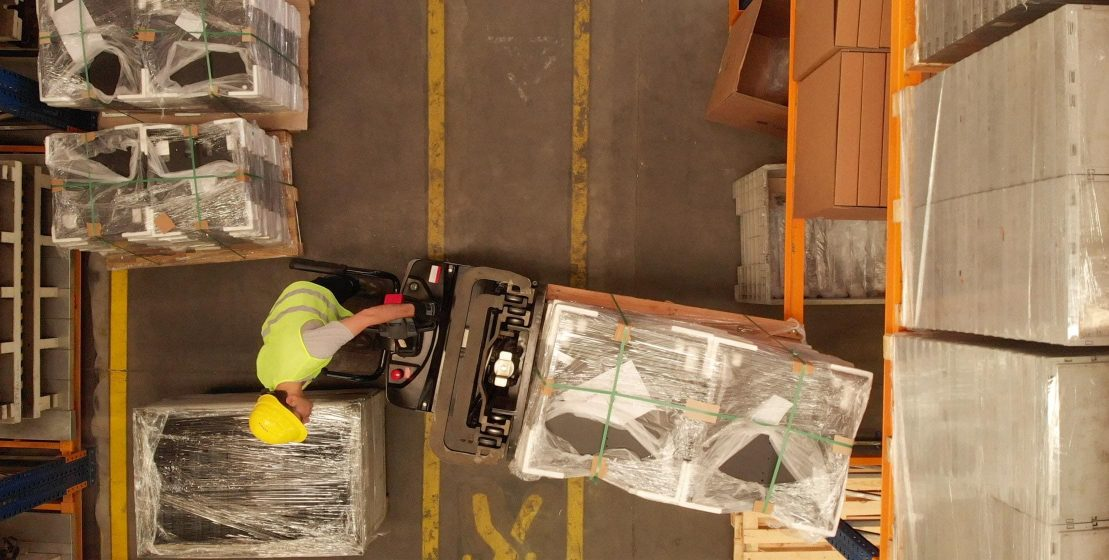 Worker moving packages
