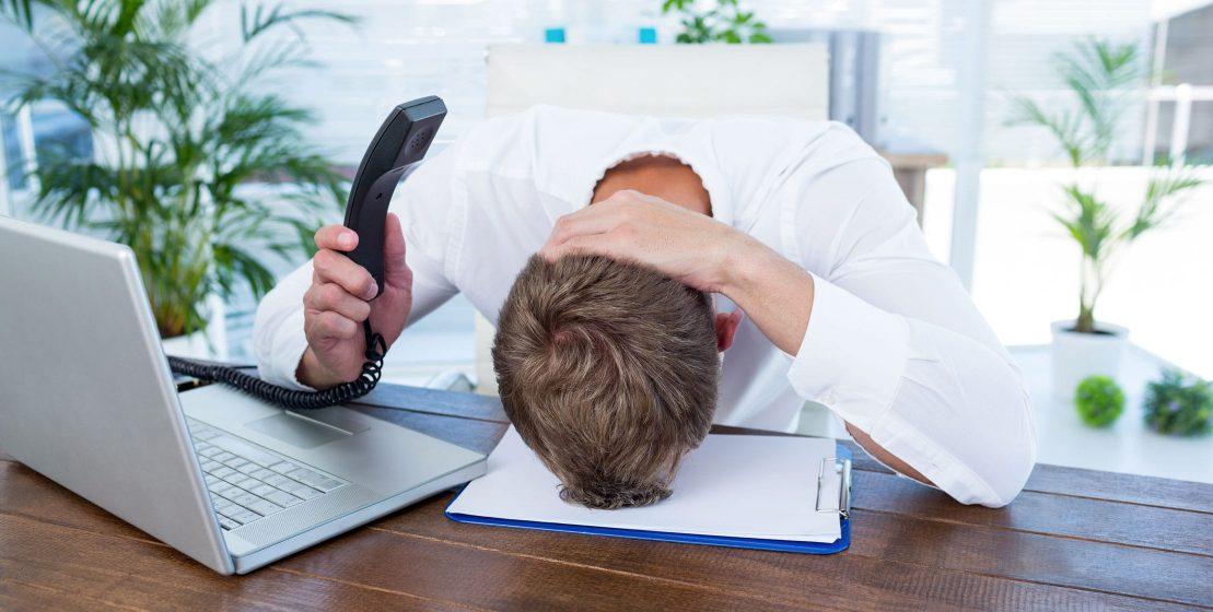 Man sitting at desk frustrated