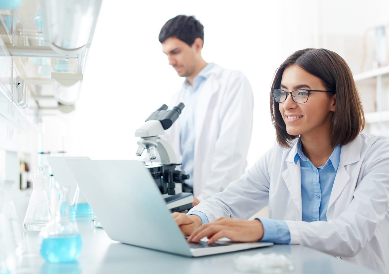 Female lab technician on the computer